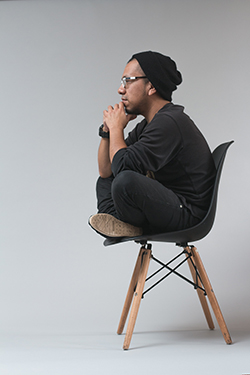 Man sitting on a chair and thinking image