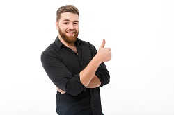 Smiling bearded man giving a thumbs up image