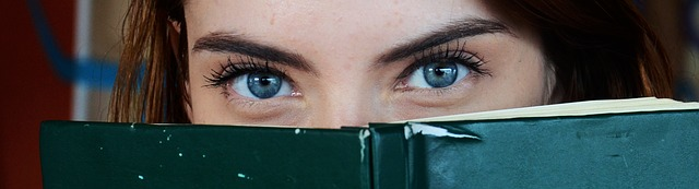 Why Eye Contact Is Important In Public Speaking - girl holding a book and making eye contact