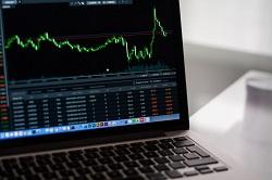 Stock Market Graph on Laptop image