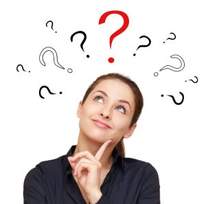 Woman thinking with question mark signs above her head