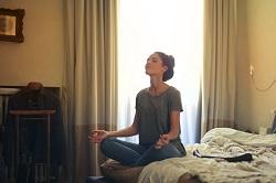Meditating inside a bedroom image