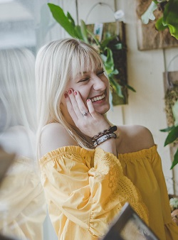 Woman with eyes closed laughing image