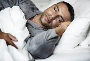 A man sleeping on a bed image
