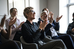 Happy business people applauding in a seminar image
