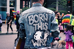 Man wearing a born this way jacket image