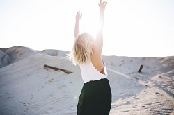 Happy woman arms raised image