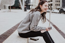 Happy woman sitting on the steps image