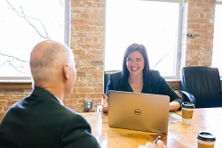 Coaching consultant talking to a client image