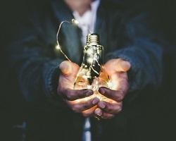 Man holding a light bulb image