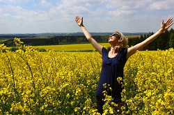A happy woman in a field of flowers image