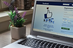 Facebook main page on a laptop image