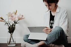 Woman at home working on tablet image