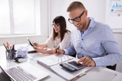 Couple calculating their taxes image