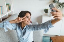 Woman taking a selfie image