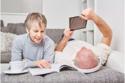 A couple reading ebooks image