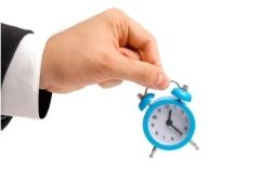 An employee holding a small clock image