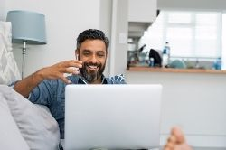 Man using a laptop for group coaching image
